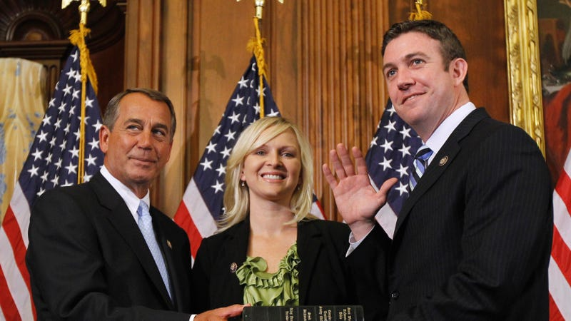 Left to right: John Boehner (not necessarily a grifter), Margaret Hunter (def a grifter) and Representative Duncan Hunter (also a grifter)