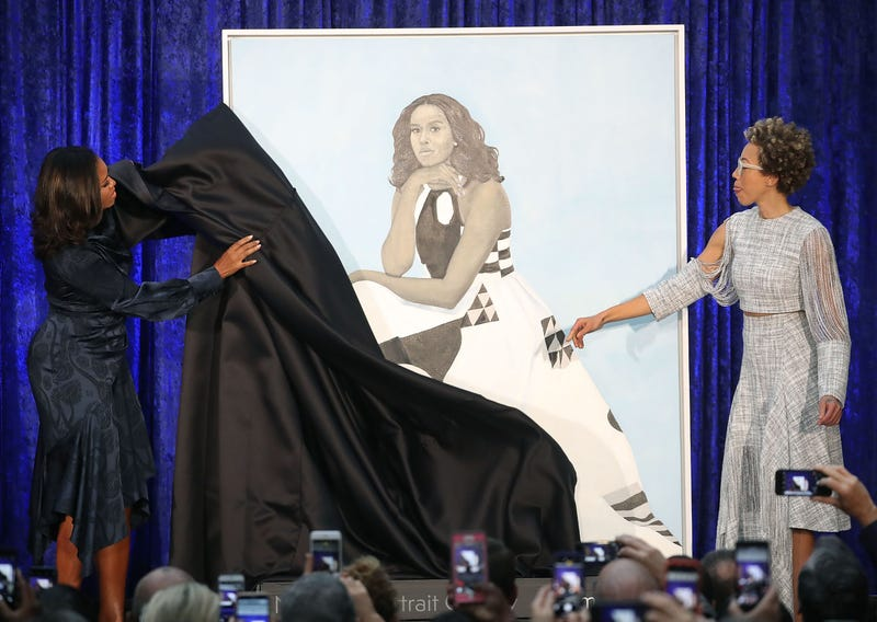 Former U.S. first lady Michelle Obama (L) and artist Amy Sherald unveil her portrait during a ceremony at the Smithsonian's National Portrait Gallery, on February 12, 2018 in Washington, DC.