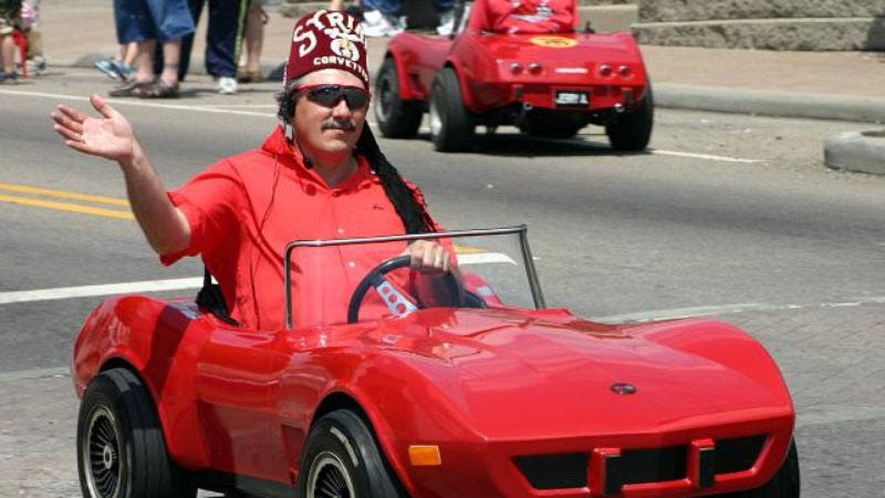 A Shriner in one of that organization's signature fezzes and miniature cars, in a 2004 Memorial Day parade. (Photo: Rick Dikeman)