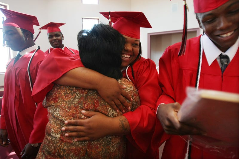 Some of the 11 students of the first and last graduating class of Livingston High School celebrating after their commencement June 3, 2008, in New Orleans. The school was set to close that summer with plans for a new elementary school to be built on the grounds.  Mario Tama/Getty Images