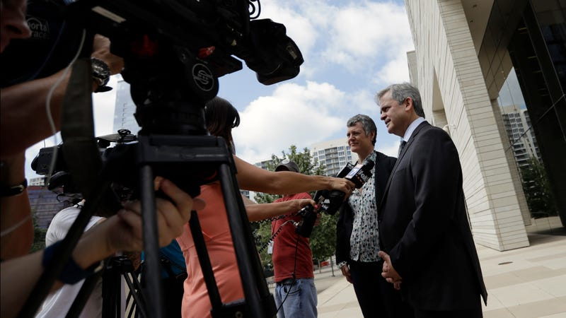 Austin Mayor Steve Adler, right, talk with the media outside the federal courthouse, Thursday, June 29, 2017, in Austin, Texas. Adler is one of more than 100 US mayors to sign the Cities Open Internet Pledge