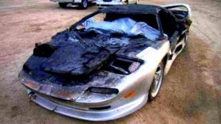 Illustration for article titled Charred Vector M12 Proves Fiberglass Body Can't Hide Italian Supercar Roots