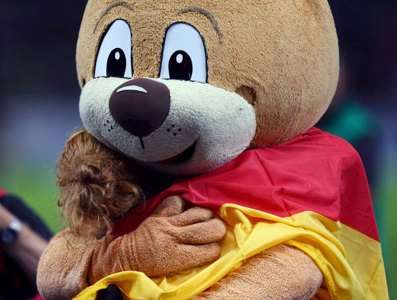 Illustration for article titled No-Nonsense Mascot Gets Right Down To Business, Hugs Child
