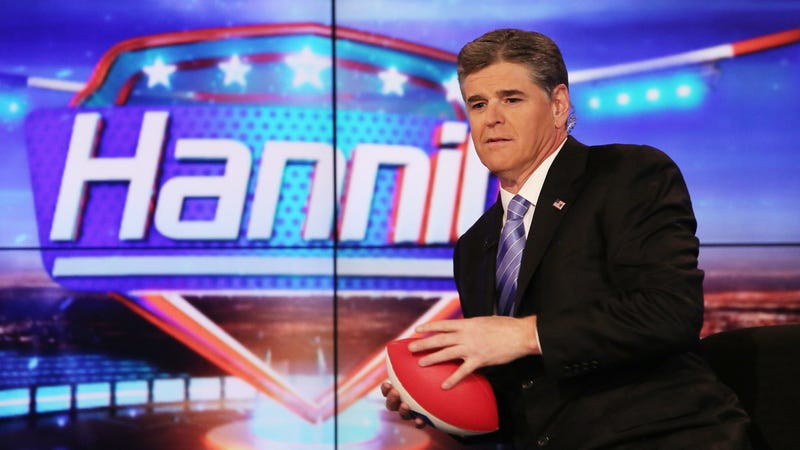 The football represents Hannity's dreams, on the verge of being chucked away. (Photo: Paul Zimmerman/Getty Images)