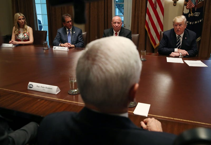 President Donald Trump, right, talks about his meeting with Russian President Vladimir Putin, during a meeting with House Republicans in the Cabinet Room of the White House on July 17, 2018 in Washington, DC.