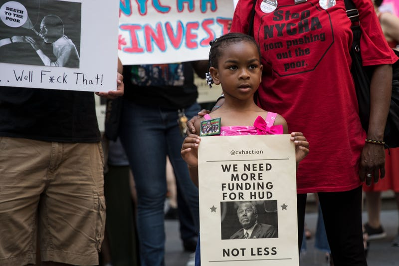 Activists rally for affordable housing and against U.S. Secretary of Housing and Urban Development Ben Carson during his appearance at the New York Stock Exchange (NYSE) to ring the closing bell, June 12, 2017 in New York City.