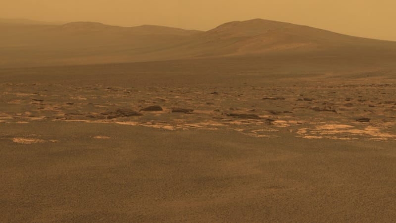 Illustration for article titled What ancient secrets are hidden in this Martian crater?