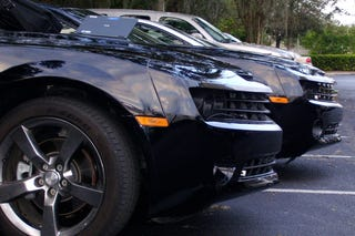 Illustration for article titled Extra Flavor, Extra Fun: Twin Black Camaros Caught On Camera