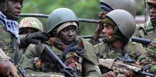 Kenyan troops are locked in a firefight with Somalian militants. (Simon Maina/AFP/Getty Images)