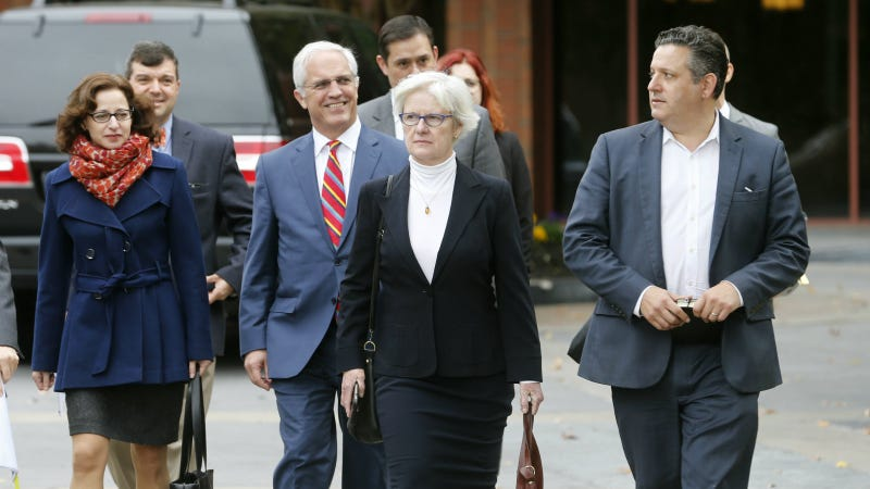 Erdely, left, and Rolling Stone magazine Deputy Managing Editor Sean Woods, right, walk with their legal team to federal court in Charlottesville, Va. this week. Photo via AP