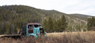 Illustration for article titled Teal & Patina'ed Commercial Cab Joins The Natural Colorado Skyline