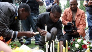 People light candles outside the house of late South African President Nelson Mandela in Johannesburg.STEPHANE DE SAKUTIN/AFP/Getty Images