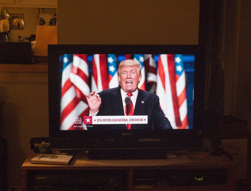 Republican presidential candidate Donald Trump delivers a speech during the Republican National Convention on July 21, 2016, at the Quicken Loans Arena in Cleveland, as shown on a television screen in Brooklyn, N.Y. Robert Nickelsberg/Getty Images