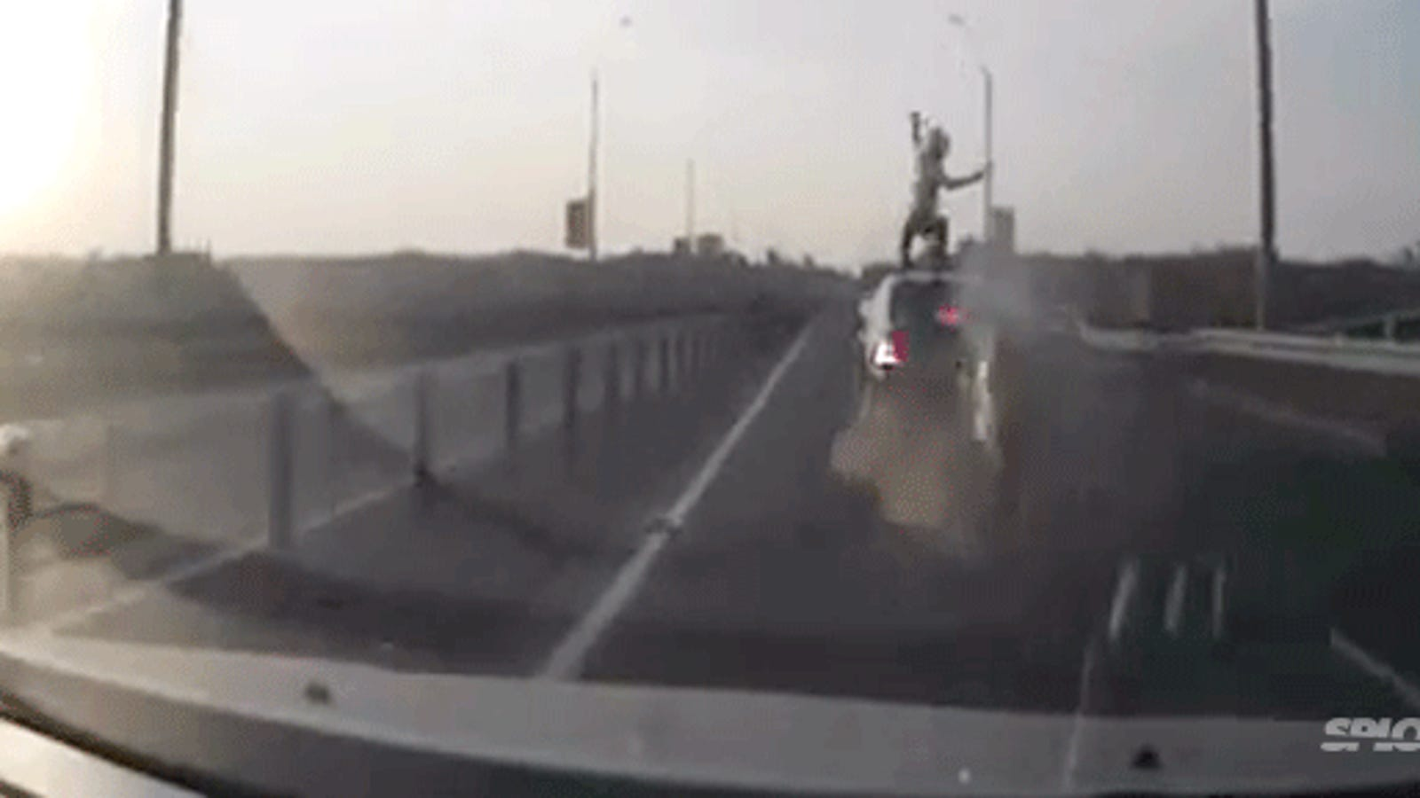 Motorcyclist crashes, flips and sticks a perfect landing on a car's roof
