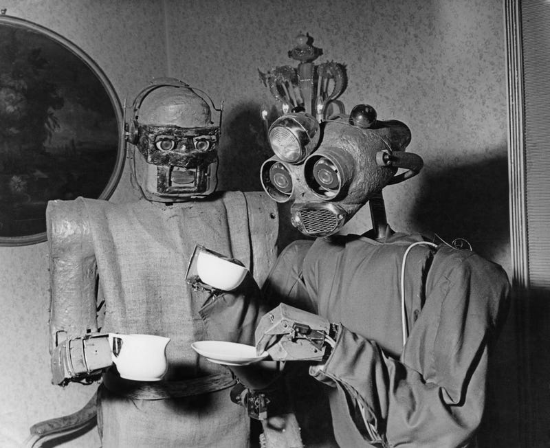 Robots' coffee break. One robot serves coffee to another in Vienna, October 1964. The machines were designed by Viennese artist Claus Scholz.