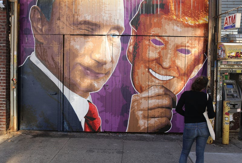 A mural depicting a winking Vladimir Putin taking off his Donald Trump mask is painted on a storefront outside the Levee bar in New York City on Feb. 25, 2017. The mural, painted by Damien Mitchell, is in Brooklyn's  Williamsburg neighborhood. (Spencer Platt/Getty Images)