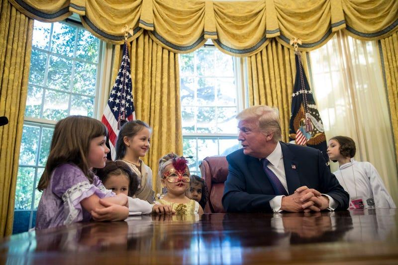 President Donald Trump meets with children of journalists, dressed for Halloween, and White House staffers in the Oval Office at the White House on Oct. 27, 2017.  (Drew Angerer/Getty Images)