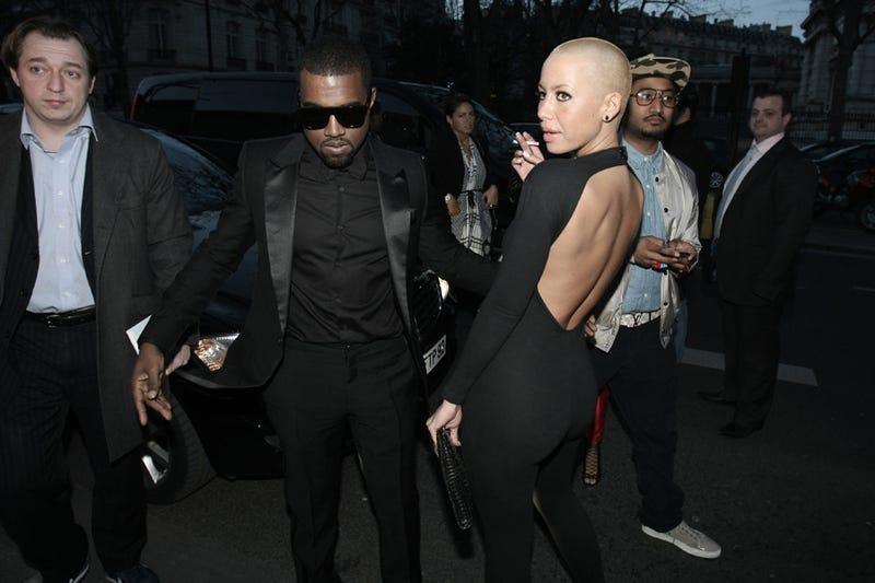 Illustration for article titled Kanye West & Ladyfriend: Le Smoking