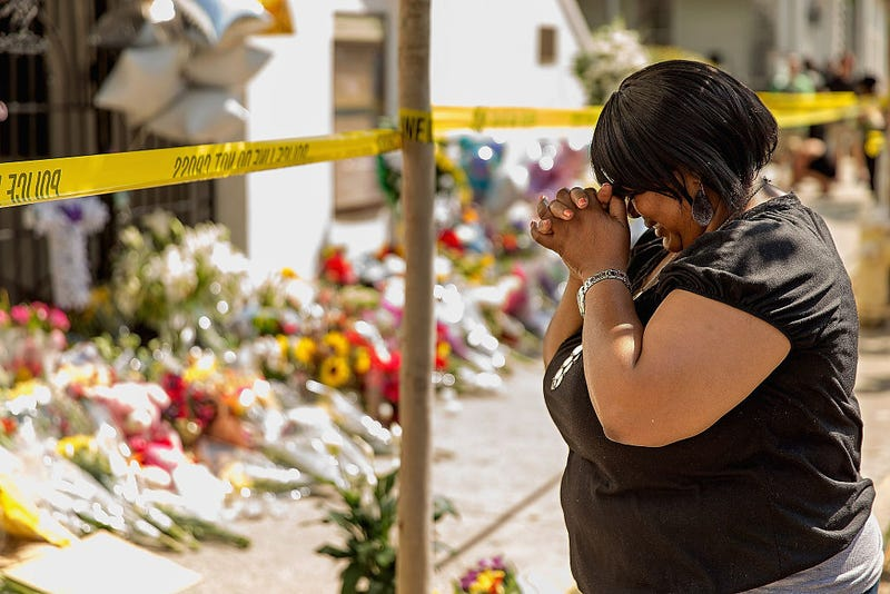 A woman weeps outside the historic Emanuel African Methodist Episcopal Church, June 19, 2015, in Charleston, S.C., after three men and six women were murdered there. (Chip Somodevilla/Getty Images)