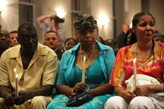 Eric Garner's stepfather, Benjamin Carr; mother, Gwen Carr; and widow, Esaw Garner, at a prayer service July 14, 2015, at Staten Island, N.Y.'s Mount Sinai United Christian Church to mark the one-year anniversary of Eric Garner's deathSpencer Platt/Getty Images