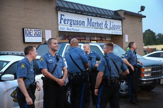 Officers with the Missouri Highway Patrol stand guard in front of Ferguson Market & Liquor on Aug. 15, 2014, in Ferguson, Mo.  (Scott Olson/Getty Images)