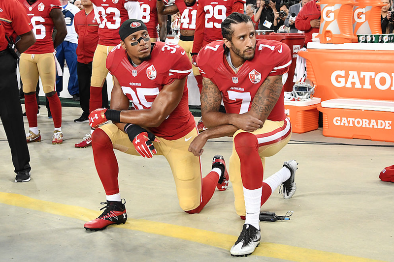 Colin Kaepernick, No. 7, and Eric Reid of the San Francisco 49ers kneel in protest during the national anthem before playing the Los Angeles Rams at Levi's Stadium  in Santa Clara, Calif., on Sept. 12, 2016. (Thearon W. Henderson/Getty Images)