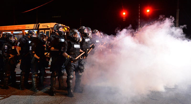 Charlotte-Mecklenburg, N.C., police officers in riot gear stand in a haze of tear gas watching protesters on Old Concord Road on Sept. 20, 2016, in Charlotte, N.C. Jeff Siner/Charlotte Observer/TNS via Getty Images