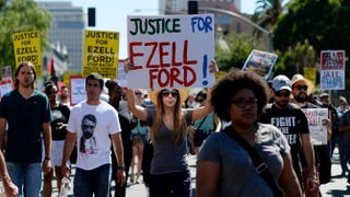 Demonstrators march in downtown Los Angeles Aug. 17, 2014, to protest the police shooting death of 25-year-old Ezell Ford. While thousands marched, some several hundred protesters rallied in front of Los Angeles Police Department headquarters to protest against recent police shootings in both Los Angeles and Missouri.Kevork Djansezian/Getty Images