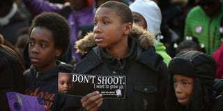 Boys at a Chicago peace vigil (Getty Images)