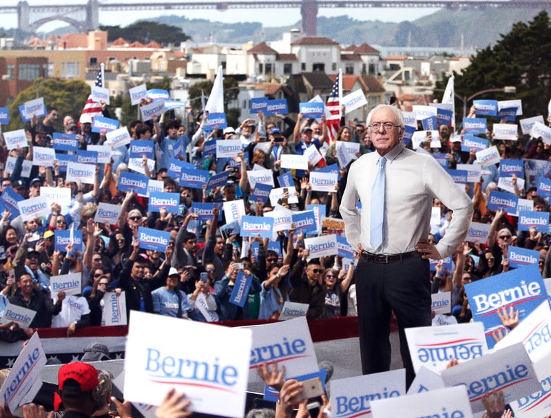 Illustration for article titled 9-Foot-Tall Bernie Sanders Greets Supporters After Session With Posture Coach