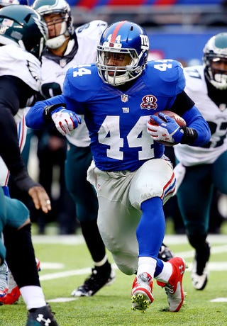 Andre Williams, No. 44 of the New York Giants, carries the ball against the Philadelphia Eagles in a game at MetLife Stadium on Dec. 28, 2014, in East Rutherford, N.J.Al Bello/Getty Images