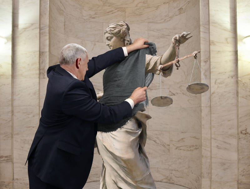 Illustration for article titled Mike Pence Drapes Shawl Over Immodest Lady Justice Statue