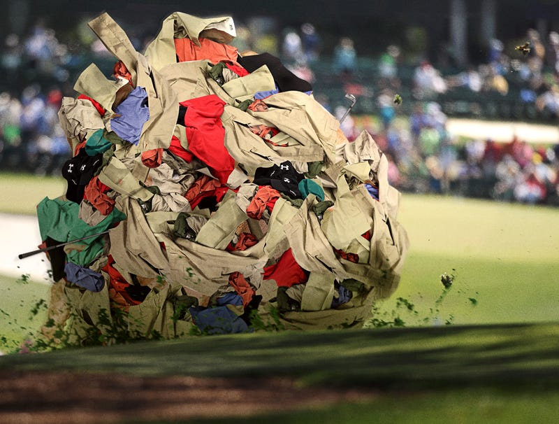 Illustration for article titled Tangled, Pulsing Mass Of Visors, Polos, And Khaki Shorts Lurches Over Hill To Next Masters Hole