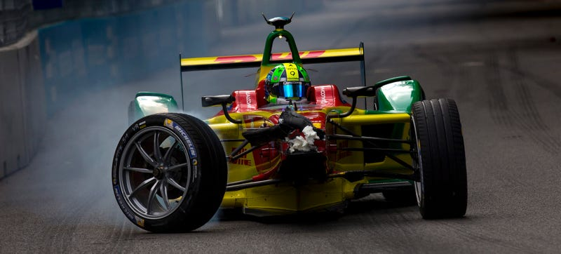 F1 reject Lucas Di Grassi wheels his crashed car back to the pits at last year's Formula E race in London. Photo Credit: Getty Images