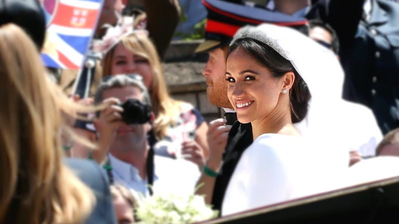 The Duke of Sussex and the Duchess of Sussex ride in the Ascot Landau carriage during the procession after getting married at St. George's Chapel, Windsor Castle, on May 19, 2018, in Windsor, England.