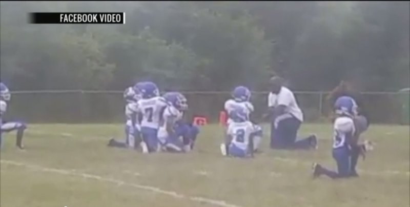 Cahokia Quarterback Club kneels during the national anthem before the team's game Sept. 17, 2017. (Fox 2 Now video screenshot)