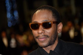 Rapper Yasiin Bey, formerly Mos Def, poses as he arrives for the screening of the film Amy at the 68th Cannes Film Festival in Cannes on May 16, 2015.LOIC VENANCE/Getty Images