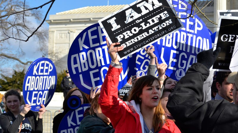 A pro-life woman clashing with a group of pro-choice demonstrators at the U.S. Supreme Court in 2015