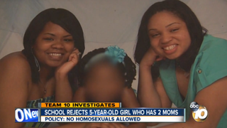 Sheena and her wife, Laushaune, pose with their daughterKGTV