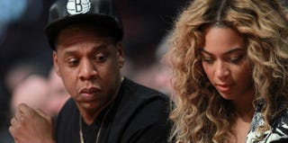 Jay Z and his wife Beyoncé attend an All-Star game earlier this year. (Ronald Martinez/Getty Images)