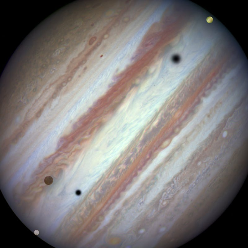 Illustration for article titled In This Breathtaking Image, Three Moons Transit the Face of Jupiter