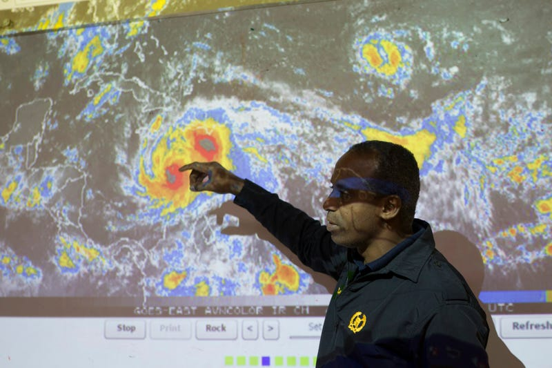 Workers of the Emergency Operation Centre in the Dominican Republic monitor Hurricane Matthew on Oct. 3, 2016, as it lumbers through the Caribbean Sea. The Category 4 hurricane is expected to hit neighboring Haiti hard, packing powerful winds and torrential rain.ERIKA SANTELICES/AFP/Getty Images