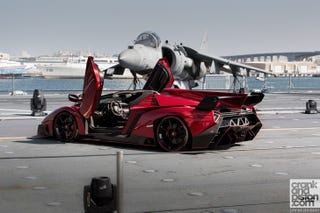 Illustration for article titled The First Veneno Roadster revealed on an Italian aircraft carrier