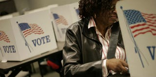 An early voter casts her ballot in Ohio. (J.D. Pooley/Getty Images)