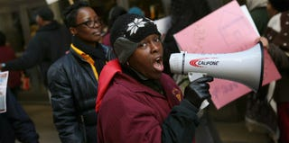 Demonstrators protest school closings outside the Chicago Public Schools offices. (Scott Olson/Getty Images)