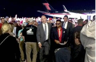C.J. Cary being escorted from a Donald Trump rally Oct. 26, 2016News & Observer Screenshot