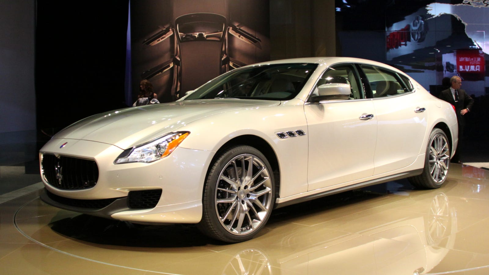 2013 maserati quattroporte quattro means four and porte means doors. Black Bedroom Furniture Sets. Home Design Ideas