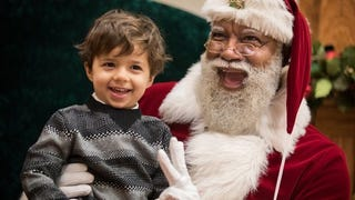 A child seated on the lap of the black Santa at the Mall of AmericaTwitter