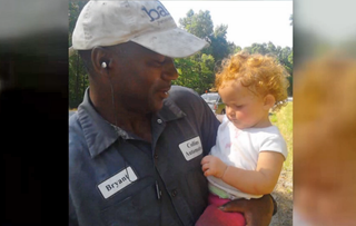Bryant Collins holds the 15-month-old child he found on the side of Highway 72.11 Alive screenshot