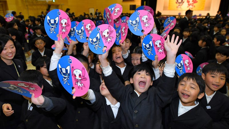 Students at the Hoyonomori Gakuen School cheer the selection of the 2020 Olympic and Paralympic mascots.